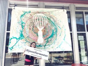 Live Painting artist, Jennifer Wester, with painting for Whisk Creperie